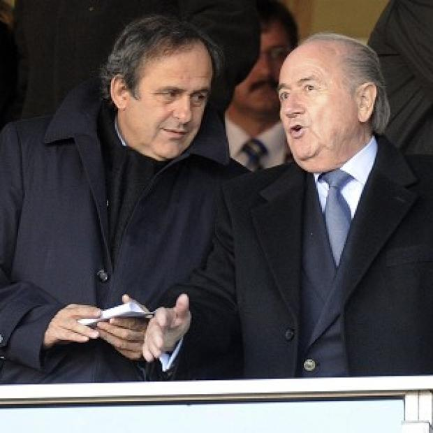 Burnley and Pendle Citizen: Michel Platini, left, backed Europe's response to Sepp Blatter's U-turn