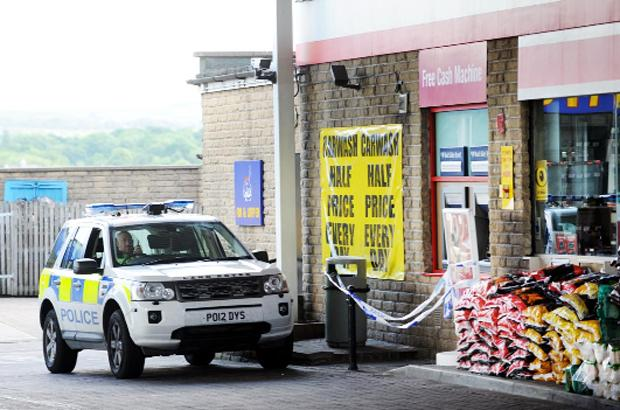 Burnley and Pendle Citizen: Police taped off the area around the cash machines