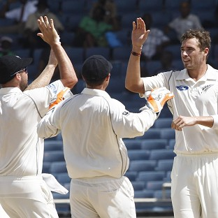 Tim Southee, right, celebrates the wicket of Kieran Powell (AP)