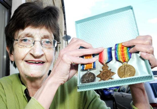 Burnley and Pendle Citizen: Jean Sanderson with the medals
