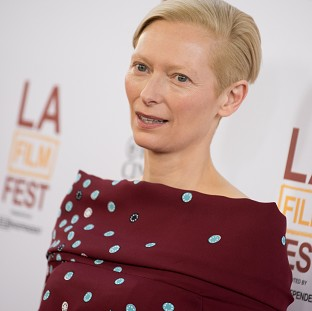 Tilda Swinton wore false teeth and a wig for her Snowpiercer role