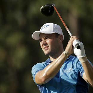 Martin Kaymer's 65 earned him a three-shot lead in the US Open on Thursday