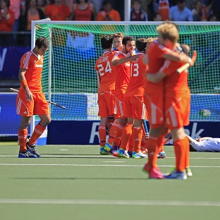 Holland's players celebrate their win over England (AP)
