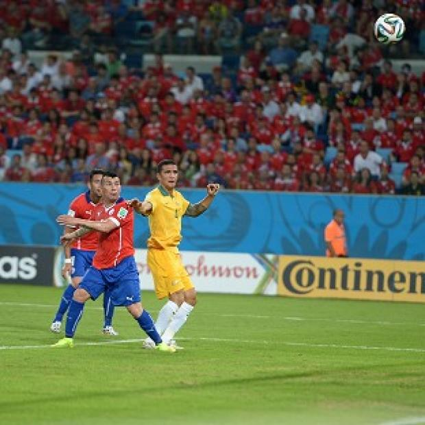 Burnley and Pendle Citizen: Tim Cahill, right, says Australia will learn from Chile defeat