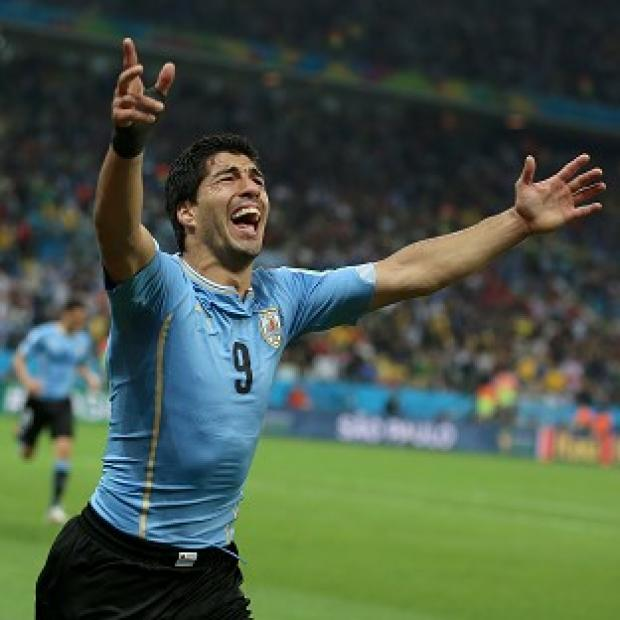 Burnley and Pendle Citizen: Luis Suarez scored twice to give Uruguay a 2-1 win over England