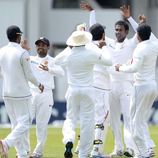 Angelo Mathews, second right, celebrates taking the wicket of Stuart Broad
