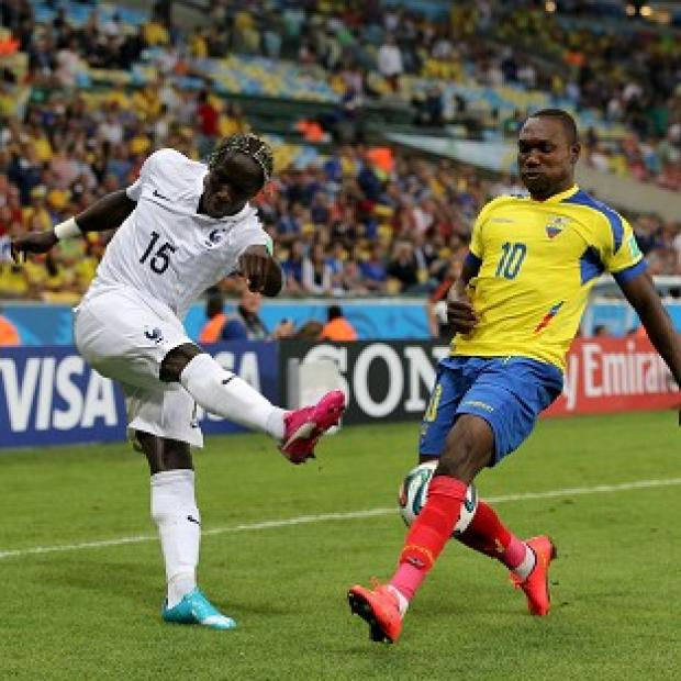 Burnley and Pendle Citizen: Ecuador's Walter Ayovi, right, and France's Bacary Sagna battle for the ball in their goalless draw
