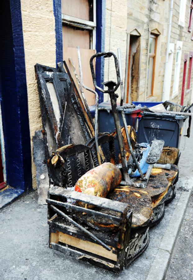 Burnley and Pendle Citizen: Burned-out furniture at the scene of the Brierfield blaze