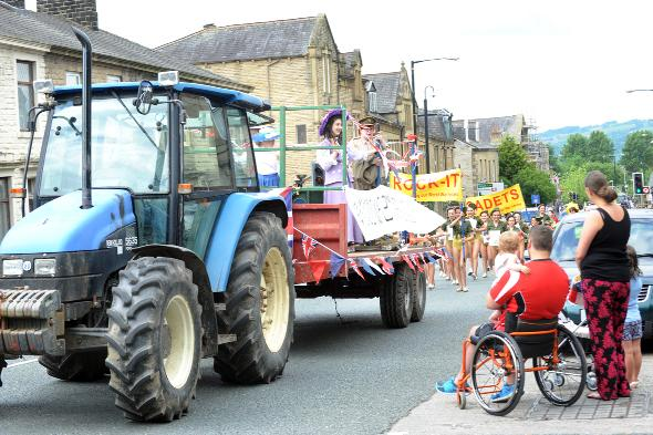 This year's procession makes its way through the town's streets.