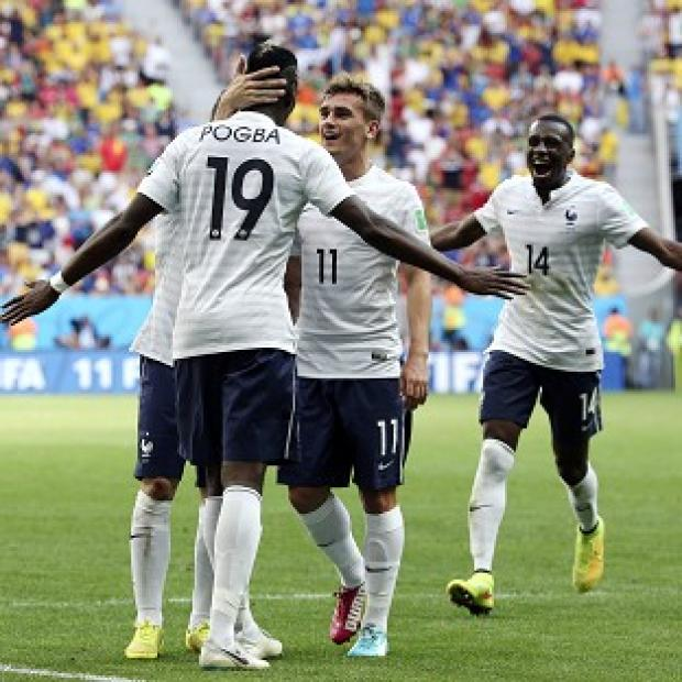 Burnley and Pendle Citizen: Paul Pogba is mobbed by his team-mates after scoring the match-winning goal (AP)