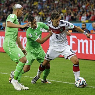Mesut Ozil, right, scored the decisive goal on a tough night for Germany against Algeria (AP)