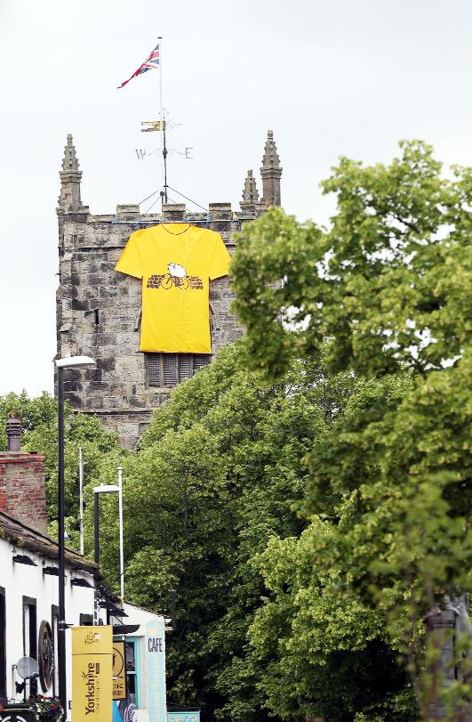 The Holy Trinty Church in Skipton  decorated with a large yellow jersey