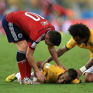 James Rodriguez, left, and Marcelo show concern for Neymar a