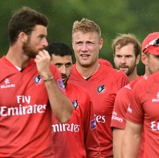 Burnley and Pendle Citizen: Andrew Flintoff, centre, and his Lancashire Lightning team-mates leave the field after a 50-run victory