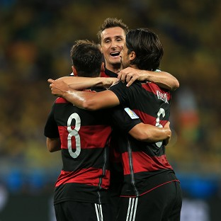 Miroslav Klose, centre, is now the leading goalscorer in World Cup competition