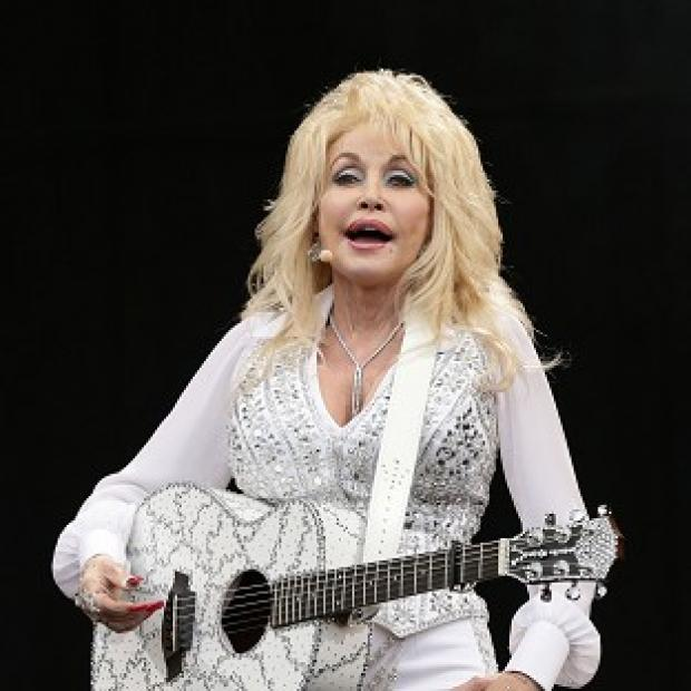 Burnley and Pendle Citizen: Dolly Parton is relieved the dog left behind at Glastonbury has been claimed by its owners