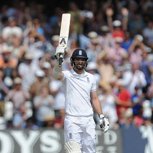 James Anderson raised his bat after reaching a maiden 50