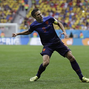 Robin van Persie celebrates the first goal (AP)