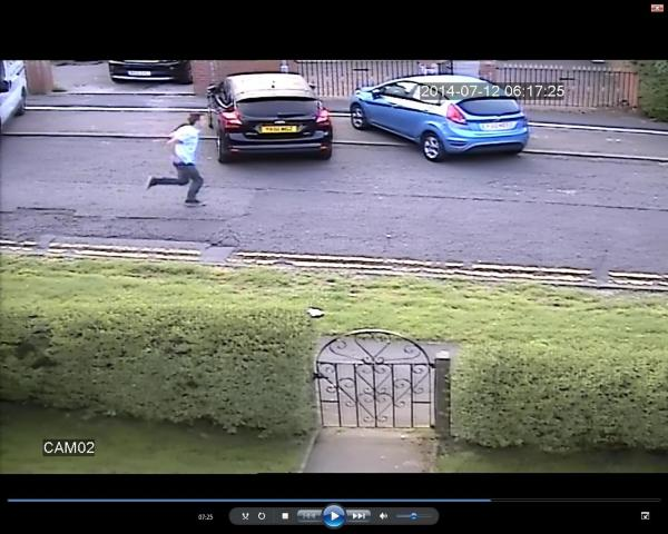 The suspect is caught on CCTV running down Ruskin Avenue in Colne