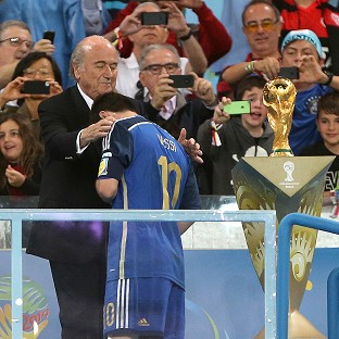 Sepp Blatter, left, consoles a dejected Lionel Messi after Sunday's World Cup final