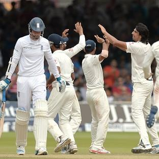 India celebrate the wicket of Stuart Broad, left, on day five at Lord's