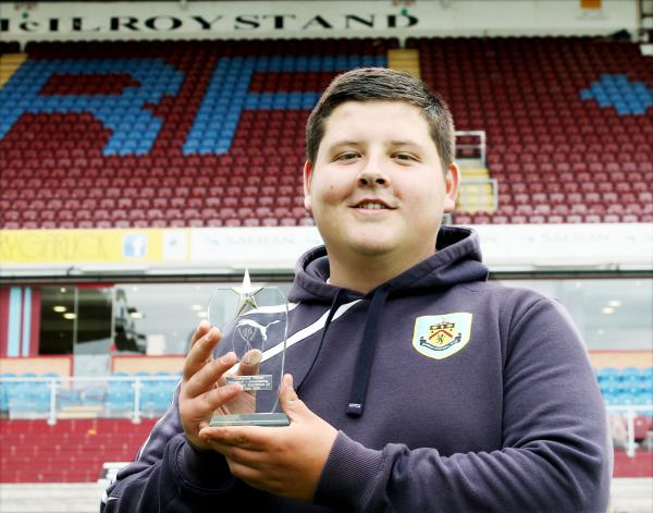 Burnley groundsman Chris Pickles has won an apprentice award for keeping the turf pristine