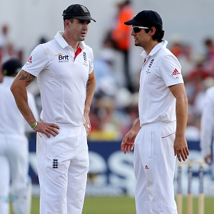 Kevin Pietersen, left, believes losing the captaincy would benefit Alastair Cook's batting