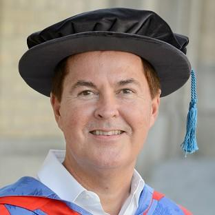 Simon Fuller receives an honorary degree of doctor of letters at the University of Brighton summer graduations