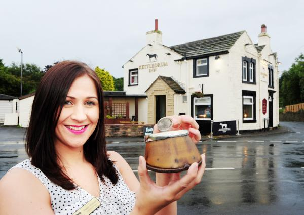 Kettledrum Inn manager Sophie Withnell with the hoof donated by  ex-pats visiting from Australia.