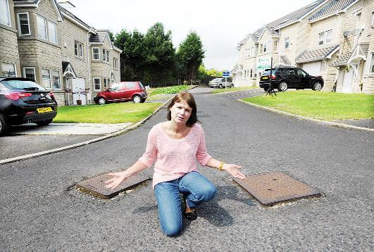 Susan Ensby and the raised manholes in May Tree Close