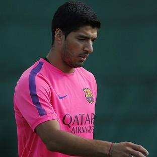 Luis Suarez was looking to the future after finally being allowed to train with his new Barcelona team-mates (AP)