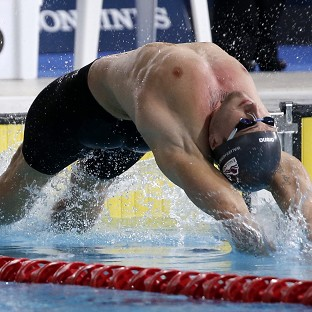 Chris Walker-Hebborn has added the European title to his Commonwealth gold after winning the 100m backstroke title in Berlin
