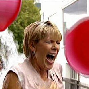 This Morning presenter Ruth Langsford is doused with ice and wat