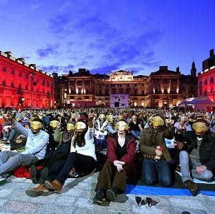 Film fans wore E.T masks to celebrate the 10th anniversary of the Film4 Summer Screen at Somerset House in London