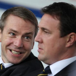 Cardiff City have sent a dossier to the FA over the behaviour of former head of player recruitment Iain Moody, left, and former manager Malky Mackay, right