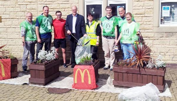 Mr Birtwistle (centre left) with clean-up team members