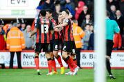 MAGNIFICENT SEVEN: Marc Pugh (right) is congratulated by his Bournemouth team-mates after netting in his side's 5-3 victory over Cardiff City at Dean Court in December - one of seven goals he has scored for the Cherries this season